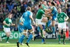 Ireland's Rob Kearney and Keith Earls with Luke McLean of Italy