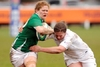 Irish prop Grace Davitt is brought down by England's Kimberley Oliver