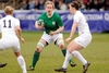 Ireland flanker Laura Guest also searches for a way past the Red Roses defence...