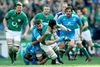 Ireland's Sean O'Brien is hauled down by Lorenzo Cittadini and Quintin Geldenhuys of Italy