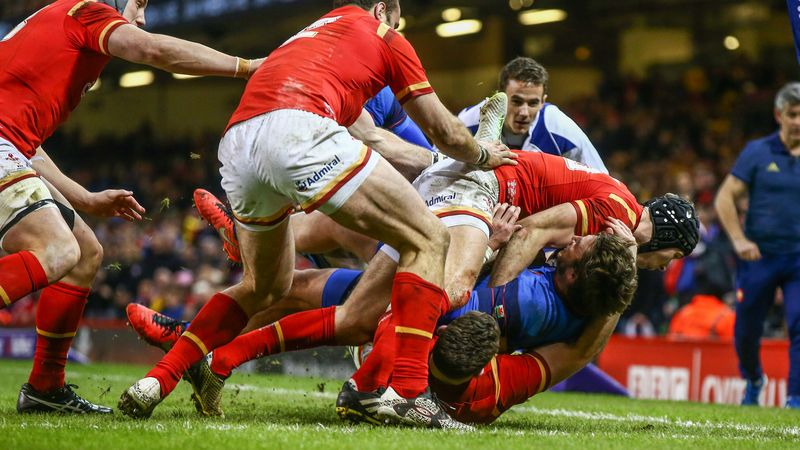 Maxime Medard is stopped by Alex Cuthbert and Liam Williams