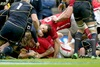 Halfpenny's boot keeps Wales' title hopes alive